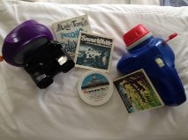 Some Disney themed View-Master reels with a projector and two viewing devices